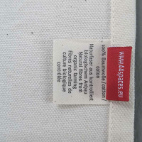 CITY TEA TOWEL. Dish towel made of cotton with coloured skyline  Light red